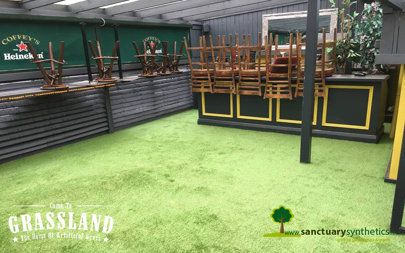 Artificial grass for outdoor smoking area of pub
